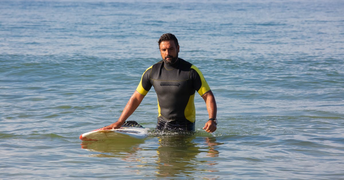 A person riding a surf board in the water
