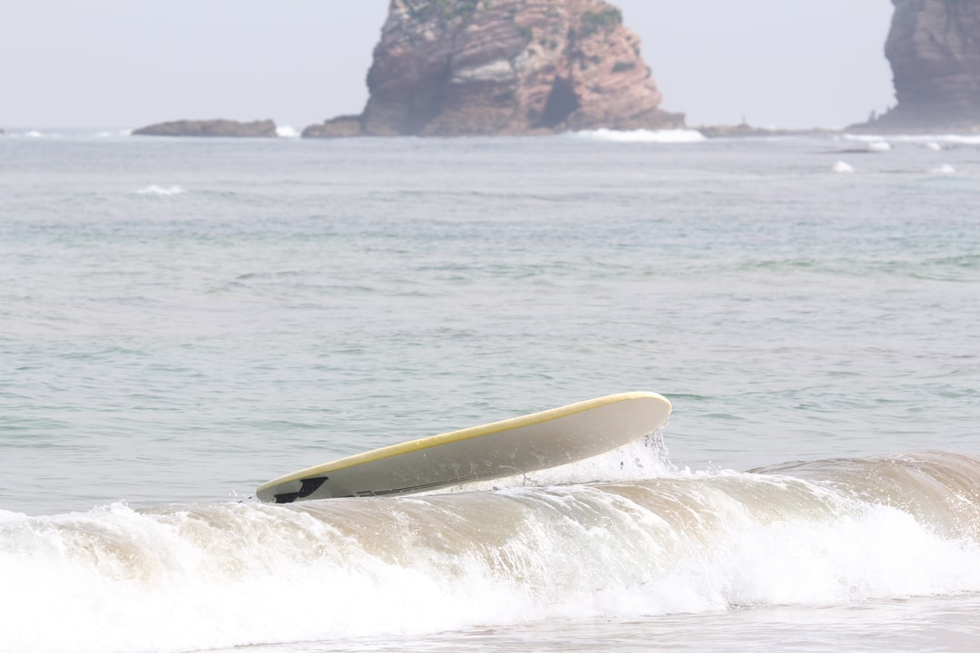 A man riding a wave on a surf board on a body of water