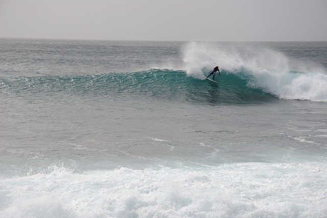 A man riding a wave on a surfboard