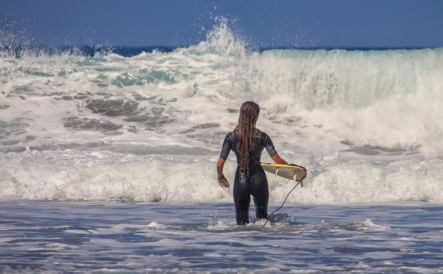 A person riding a wave on a surfboard in the water